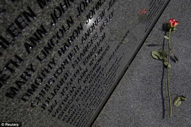 A rose lies on the base of the main headstone in the Lockerbie Air Disaster Memorial garden in Lockerbie